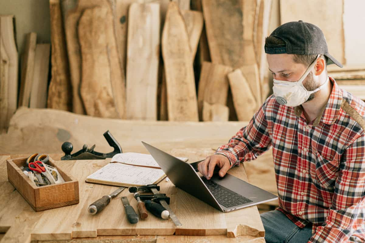 Woodworking By LPI - Man Wear Mask At Computer